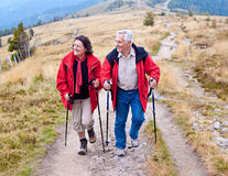 Hiking seniors 15. Seniorcouple hiking in the nature stock photography
