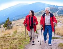 Hiking seniors 17. Seniorcouple hiking in the nature royalty free stock photos