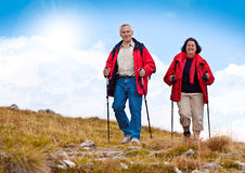 Hiking seniors 20. Seniorcouple hiking in the nature stock photo