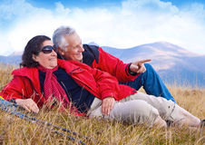 Hiking seniors 23. Seniorcouple hiking in the nature royalty free stock images