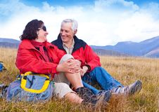 Hiking seniors 24. Seniorcouple hiking in the nature stock images
