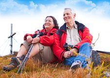Hiking seniors 28. Seniorcouple hiking in the nature royalty free stock photo