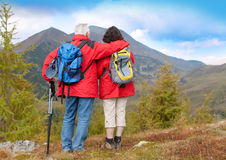 Hiking seniors 4. Cute seniorcouple hiking in an autumn mountainlandscape. landscape format stock image
