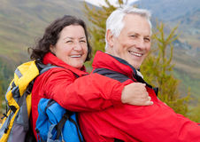 Hiking seniors 6. Cute seniorcouple hiking in an autumn mountainlandscape royalty free stock photography