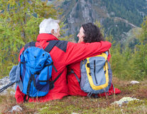 Hiking seniors 8. Cute seniorcouple hiking in an autumn mountainlandscape royalty free stock image