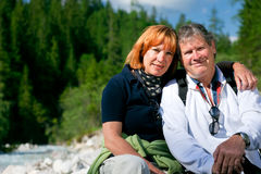 Hiking Seniors. A senior couple is hiking in berchtesgaden bavaria, germany stock image