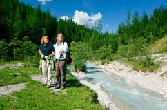 Hiking Seniors. A senior couple is hiking in berchtesgaden bavaria, germany and enjoying the magnificent landscape stock photos