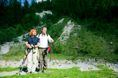 Hiking Seniors. A senior couple is hiking in the mountains royalty free stock photography