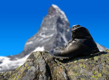 Hiking shoe on the rock Stock Images