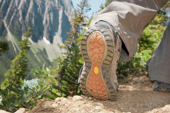 Hiking shoes. Sporty hiking shoes worn by a male on a Paget Lookout trail in Banff National Park, Canada Royalty Free Stock Photography