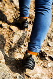 Hiking shoes closeup,walking on mountain road Royalty Free Stock Photography