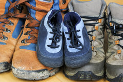 Hiking shoes. From father, mother and baby Stock Image