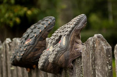 Hiking shoes on a fence Stock Images