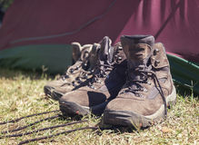 Hiking shoes in front of tent Royalty Free Stock Photography