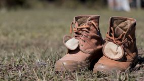 Hiking shoes On the hay grass royalty free stock image