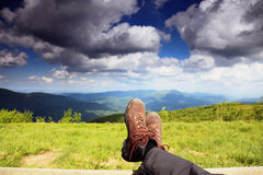 Hiking shoes. Hiker enjoying view relaxing Stock Photos