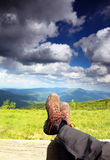 Hiking shoes. Hiker enjoying view relaxing Stock Image
