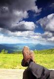 Hiking shoes. Hiker enjoying view relaxing Stock Image