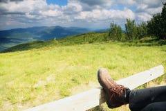 Hiking shoes. Hiker enjoying view relaxing Royalty Free Stock Photos
