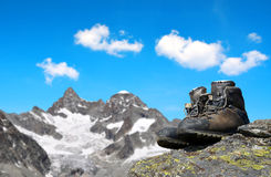 Hiking shoes on the rock. In the background mount Gabelhorn - Pennine Alps, Switzerland stock photo