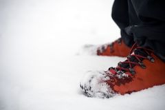 Hiking shoes on snow Royalty Free Stock Image