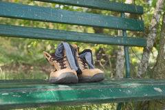 Hiking shoes with socks on bench Stock Image