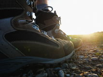 Hiking shoes sun. Hiker walking in the path with hiking boots.hiking shoes sun Selective focus Stock Photos