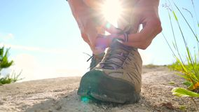 Hiking shoes - woman tying shoe laces stock video
