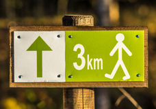 Hiking sign with distance 3 km Royalty Free Stock Photo