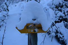 Hiking sign with snow. Hiking sign with a lot of snow on it Stock Images