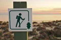 Hiking sign in near lake at sunset Royalty Free Stock Image