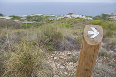 Hiking sign at trekking path beside the coast Royalty Free Stock Photography