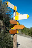 Hiking signpost. Wooden hiking trail signpost with multiple directions, signs empty for text royalty free stock photo