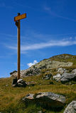 Hiking Signpost with Grass. Signpost of hiking trails in the French Alps Royalty Free Stock Photos