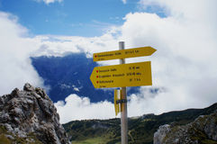 Hiking signs. In the Stubai Alps in Tyrol; clouds and blue sky; in the foreground rocks Stock Images