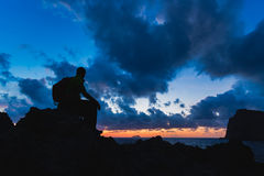 Hiking silhouette backpacker, man looking at ocean. Hiker or runner silhouette backpacker, man looking at inspirational ocean landscape and islands on mountain Royalty Free Stock Photography
