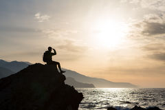 Hiking silhouette backpacker, man looking at ocean. Hiker or runner silhouette backpacker, man looking at inspirational ocean landscape and islands on mountain Stock Image