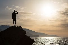 Hiking silhouette backpacker, man looking at ocean. Hiker or runner silhouette backpacker, man looking at inspirational ocean landscape and islands on mountain Royalty Free Stock Photo