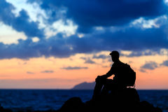 Hiking silhouette backpacker, man trail runner in mountains Stock Image