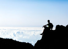 Hiking silhouette backpacker, man trail runner in mountains. Hiking or running silhouette backpacker, man and success in mountains on mountain peak. Fitness and Royalty Free Stock Images