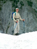 Hiking in the snow. Man hiking in Banff NP, Canada, during summer Royalty Free Stock Image