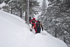 Hiking in snowstorm Royalty Free Stock Photos