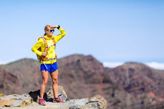 Hiking success, happy woman backpacker climbing in mountains Stock Images