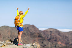 Hiking success, happy woman in mountains Stock Images