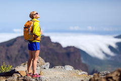 Hiking success, happy woman in mountains Royalty Free Stock Photo