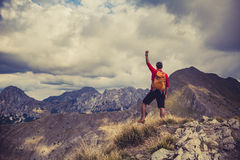 Hiking success, man runner in mountains Stock Photos