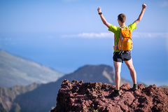 Hiking success, trail runner man in mountains. Hiker or trail runner man and success in mountains. Fitness and healthy lifestyle outdoors in summer nature Stock Photography