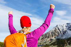 Hiking success, woman in mountains Stock Images