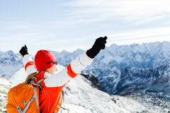 Hiking success, woman in winter mountains. Hiking woman and success in winter mountains. Fitness and healthy lifestyle outdoors in snowy nature. Female Stock Photo
