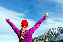 Hiking success, woman in winter mountains. Hiking woman and success in mountains. Fitness and healthy lifestyle outdoors in winter nature Stock Image